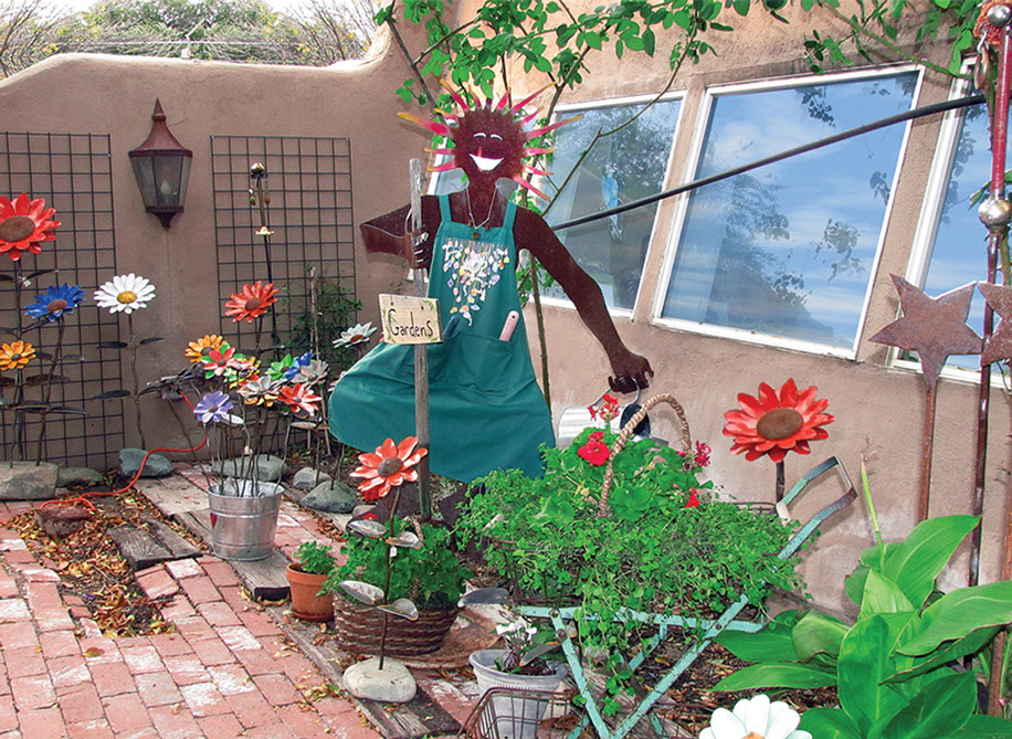 Yard Woman sculpture outside shop